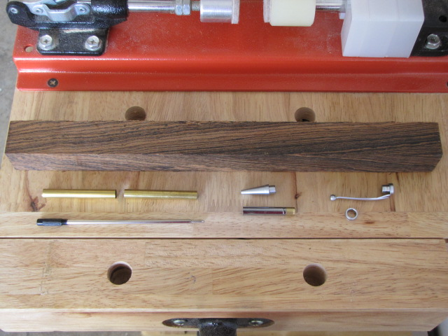 all of the parts necessary to turn a slimline wooden pen