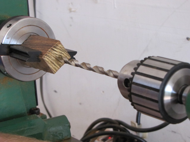 pull your tailstock up to the pen blank
