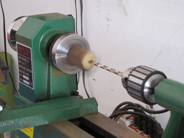 turn the lathe on and start drilling the hole
