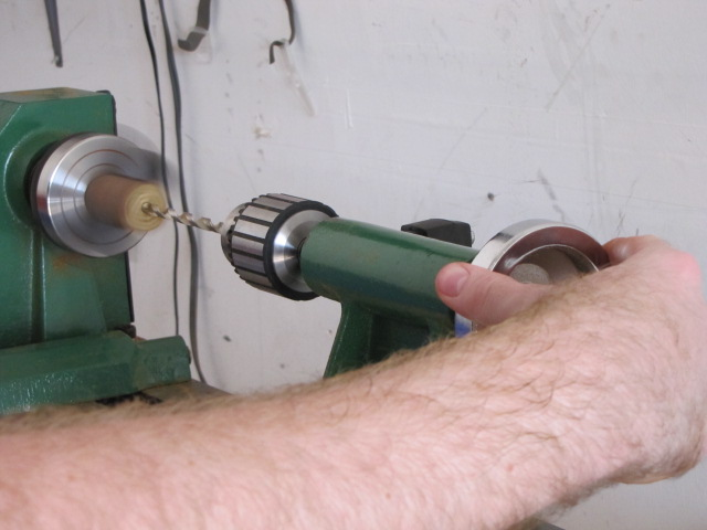 continue turning the handwheel until the tailstock is fully extended