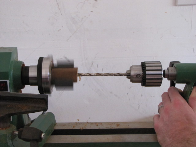 finish drilling the hole in the pen blank