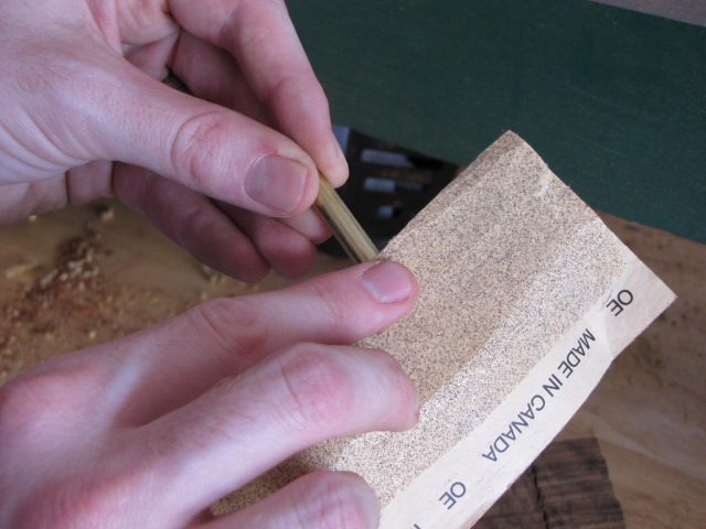 sanding brass tubes before gluing them into the pen blank