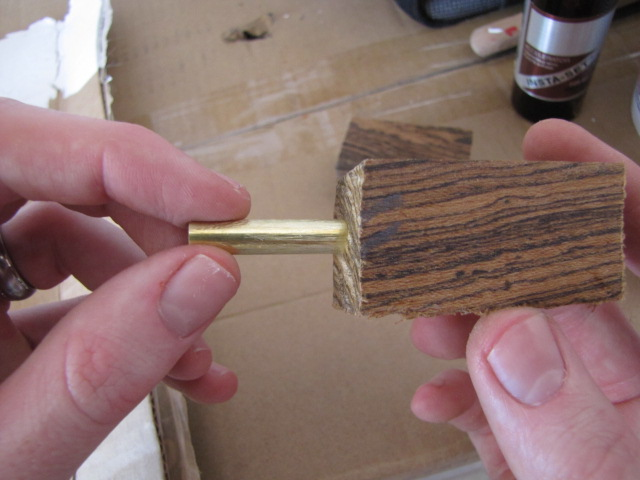 insert the brass tube into the grain match side of the pen blank