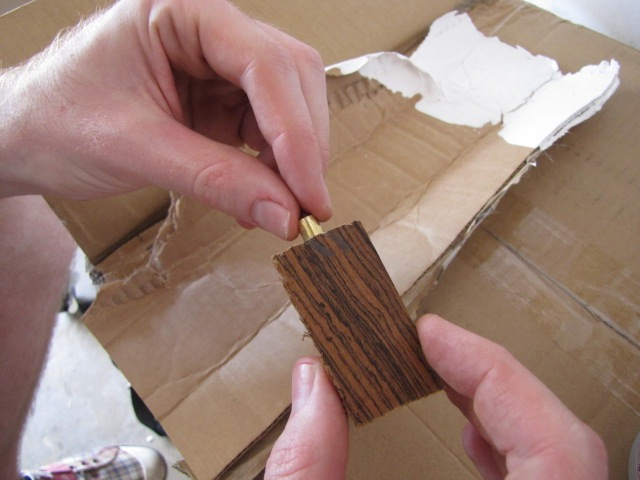 inserting the brass tube into the pen blank