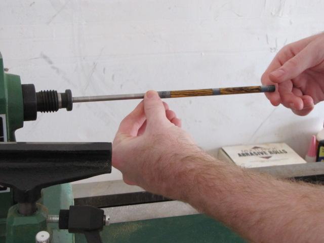 removing finished slimline barrels from the mandrel