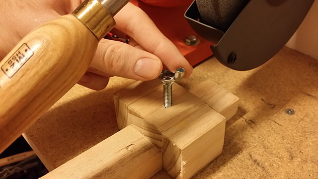 tighten your bracket onto the arm/base of the jig so it won't move with grinder vibration
